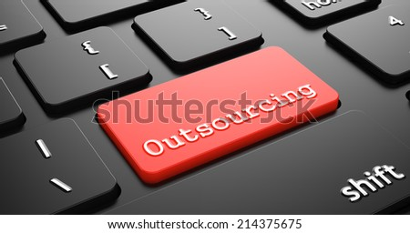 Outsourcing on Red Button Enter on Black Computer Keyboard. - stock photo