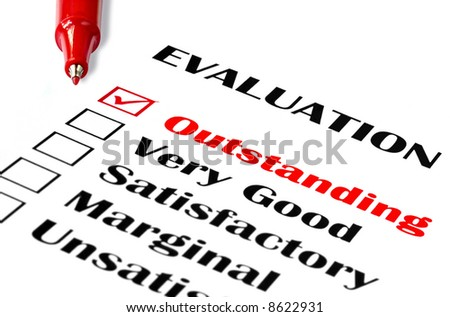 "Outstanding evaluation.  Red pen on evaluation, with ""outstanding"" checked. - stock photo"