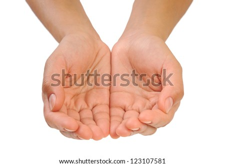 Outstretched cupped hands of young woman - stock photo