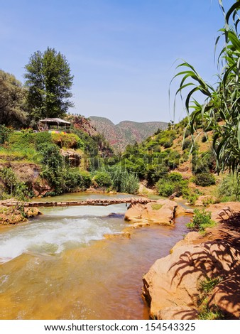 Ouzoud River located in the Grand Atlas province of Azilal, 150 km northeast of Marrakech, Morocco, Africa - stock photo