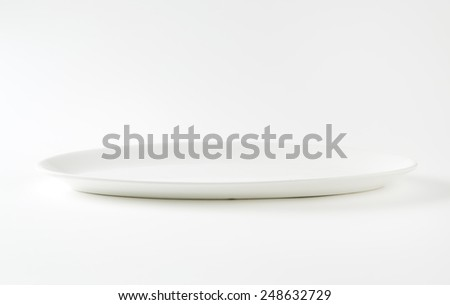 Oval plain white serving plate - stock photo