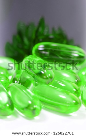 Oval shape of soft gelatin capsule use in pharmaceutical manufacturing for contain oily drug and nutritional supplement like vitamin A, E, fish oil, primrose oil, rice barn oil and other oily drugs. - stock photo