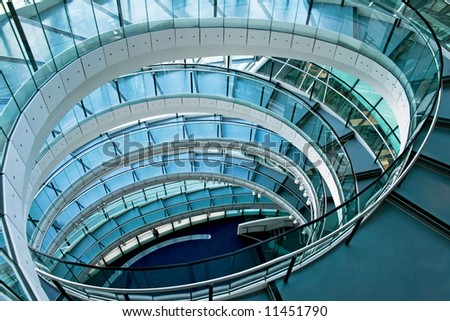 Oval stairway in the middle of office building - stock photo