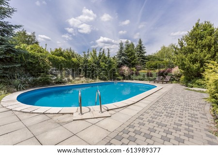 Swimming pool garden  Oval Swimming Pool Garden Area Surrounded Stockfoto (Lizenzfrei ...