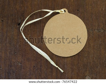 oval tag over wooden background - stock photo