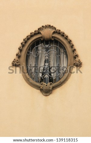 Oval window decorated with relief contour - stock photo