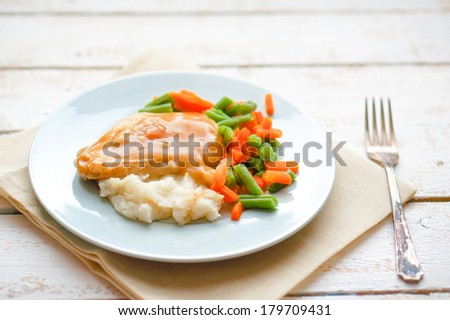 Oven baked chicken with mashed potatoes and vegetables - stock photo
