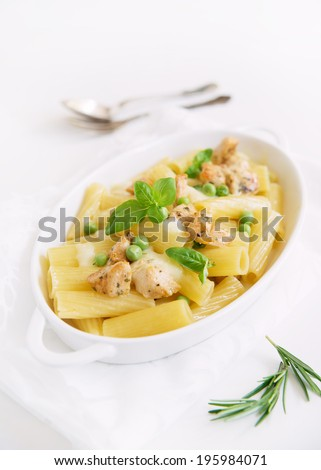oven baked pasta with chicken and green peas - stock photo