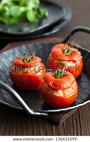 oven baked tomatoes with rice and onions - stock photo