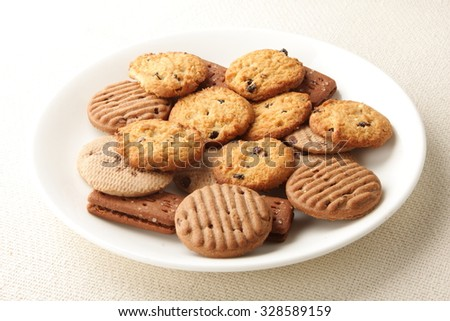 Oven fresh cookies and biscuits served in plate.. - stock photo