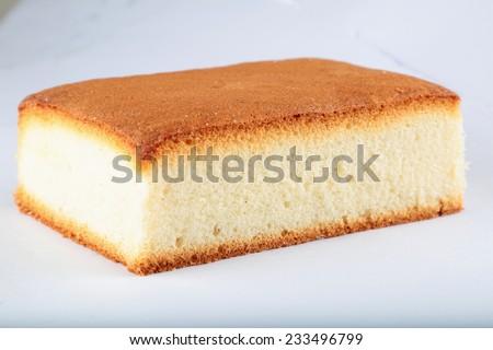 Oven fresh sponge cake  - stock photo