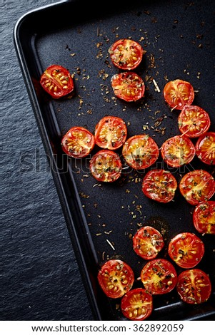 Oven roasted cherry tomatoes with oregano - stock photo