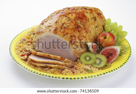 Oven roasted ham served with fried cassava flour and fruit. Modern rendering of a traditional Christmas dish - stock photo