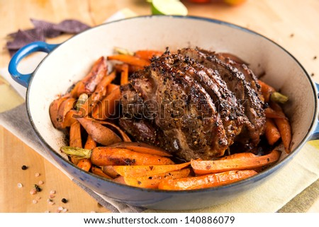 Oven Roasted Pork Shoulder in Pan with Carrots and Sweet Potatoes - stock photo