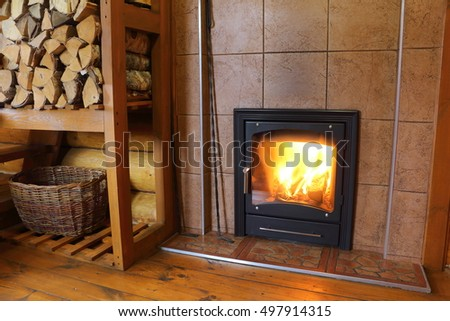 Oven with burning wood.