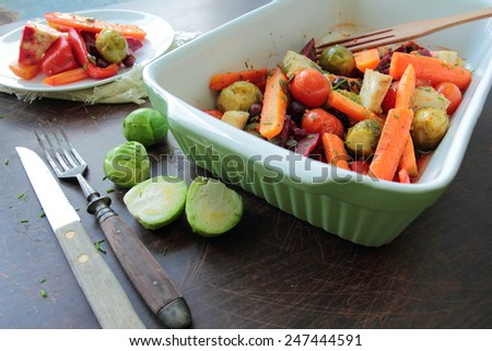 Oven with roasted vegetables  - stock photo
