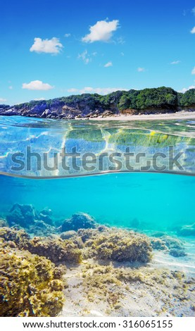 over and under water surface of a Sardinian beach, Italy - stock photo