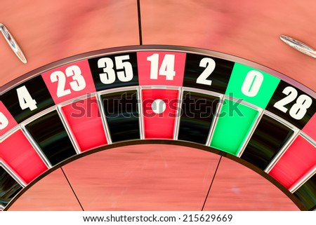 Over head sot of an American roulette wheel winning number fourteen
