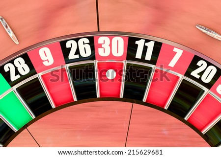 Over head sot of an American roulette wheel winning number thirty - stock photo