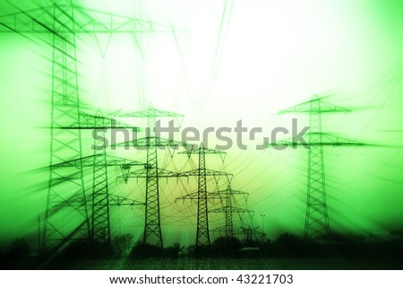 over land energy mast with metal cable - stock photo