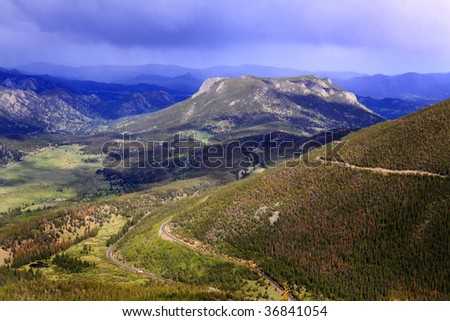 Over looking scenic view from mountain top in early spring in Rocky Mountain Co - stock photo