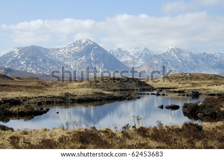over Rannoch Moor and lochans to mountains of Glencoe - stock photo