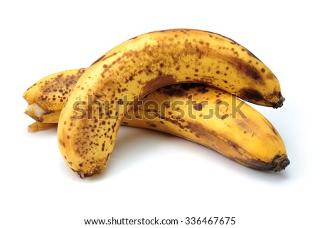 Over ripe banana isolated on white with clipping path - stock photo