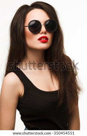 over-sized round black sunglasses fashion. Pretty young sexy fashion sensual woman in retro round sunglasses, retro outfit,Stylish fashionable brunette girl hipster. White background.  - stock photo
