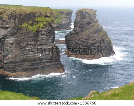 Over the edge. Dramatic Irish coast. - stock photo