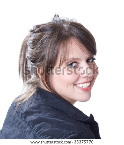 Over the right shoulder young woman portrait; close-up; isolated on a white background. - stock photo