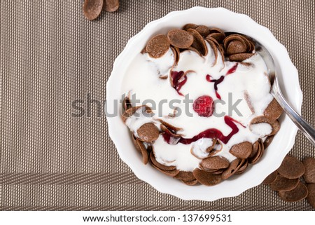 Over view on jam face on creamy flakes - stock photo