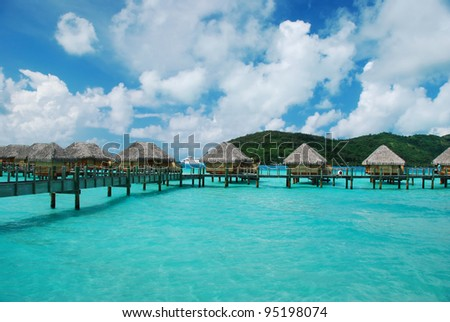 Over water bungalow and turquoise-color lagoon . - stock photo