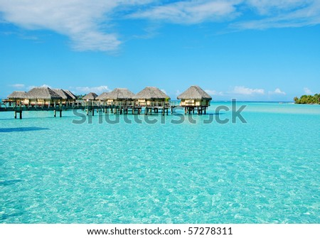 over water bungalow at bora bora - stock photo