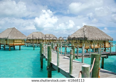 over water bungalow on the turquoise lagoon - stock photo