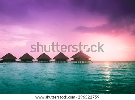 Over water bungalows - stock photo