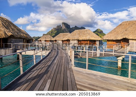 Over water bungalows in Bora Bora Island. - stock photo