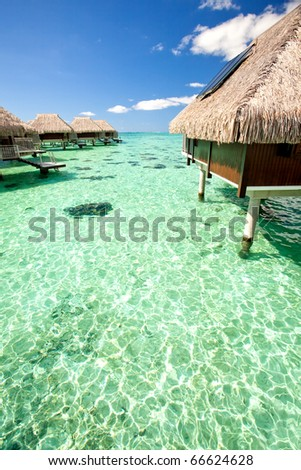Over water bungalows over amazing tropical lagoon - stock photo