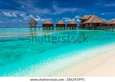 Over water spa on an island with amazing green lagoon with coral - stock photo