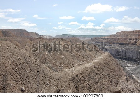 overburden and the visible coal seam at the backdrop in a coal mine - stock photo