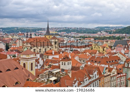 Overcast sky above the roofs of old Prague - stock photo