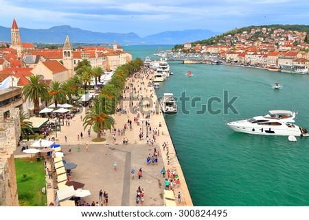 Overcast sky and tourist boats on the Adriatic sea near Venetian town of Trogir, Croatia - stock photo