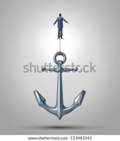 Overcoming limitations and adversity as a business concept of liberation to escape the obstacles of life as a businessman rising up lifting a heavy anchor achieving success with the power of belief. - stock photo