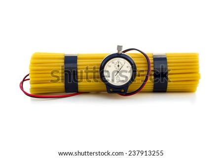 OVERCONSUMPTION OF CARBOHYDRATES 3 - A pack of spaghetti wrapped in a way that resembles explosives. - stock photo