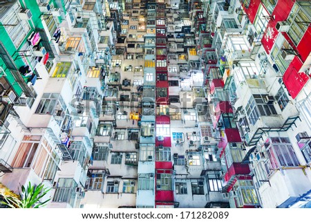 Overcrowded building in Hong Kong - stock photo