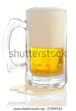 Overfilled beer mug isolated on white