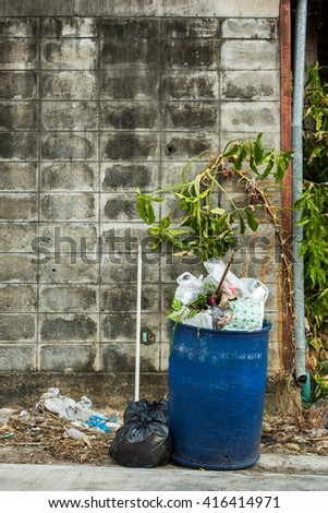 overfilled trash of large bin for rubbish - stock photo