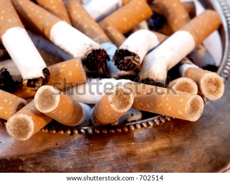 overflowing ashtray - stock photo