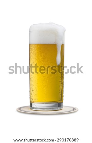 overflowing beer glass on a beermat on white background