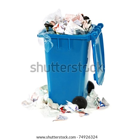 overflowing blue garbage bin on white background - stock photo