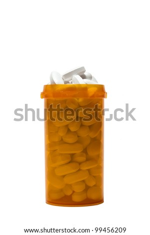 Overflowing bottle of prescription pills - stock photo